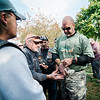 "Travis Vallee hands out pins as ""The Wall That Heals"" arrives at Leominster's Carter Park on Wednesday afternoon. The 250-foot replica of the Vietnam Wall traveled through the city on Wednesday morning and will be stationed at Carter Park through Sunday. SENTINEL & ENTERPRISE / Ashley Green"