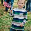 "Devin Bean, 4, of Fitchburg, waves a flag as ""The Wall That Heals"" arrives at Leominster's Carter Park on Wednesday afternoon. The 250-foot replica of the Vietnam Wall traveled through the city on Wednesday morning and will be stationed at Carter Park through Sunday. SENTINEL & ENTERPRISE / Ashley Green"
