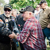 "Vietnam Navy veteran Barry Neas greets Army veteran Roger Goguen as ""The Wall That Heals"" arrives at Leominster's Carter Park on Wednesday afternoon. The 250-foot replica of the Vietnam Wall traveled through the city on Wednesday morning and will be stationed at Carter Park through Sunday. SENTINEL & ENTERPRISE / Ashley Green"