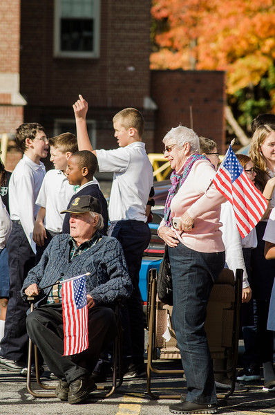 "Spectators gather on Main Street in Leominster as they await ""The Wall That Heals."" The 250-foot replica of the Vietnam Wall traveled through the city on Wednesday morning and will be stationed at Carter Park through Sunday. SENTINEL & ENTERPRISE / Ashley Green"