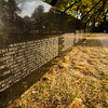 """The Wall That Heals"" on display at Leominster's Carter Park on Wednesday evening. The 250-foot replica of the Vietnam Wall traveled through the city on Wednesday morning and will be stationed at Carter Park through Sunday. SENTINEL & ENTERPRISE / Ashley Green"