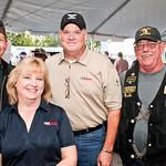 Rob Soice, Susan Patton and USA Cares Executive Director Hank Patton and Harvey Schirrmacher.