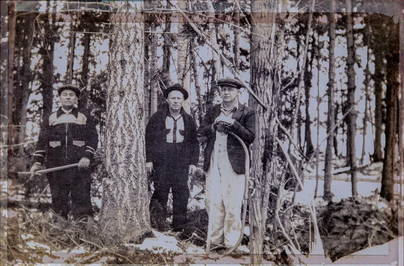 my paternal grandfather between two friends 1930ish. <br /> Saskatchewan