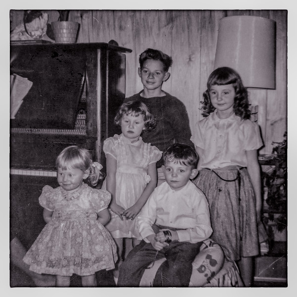 from left to right, my cousin Pam, my sister Cyndi, my uncle Gordon, my cousin Karrie, and me, Christmas 1961 at my grandparents.