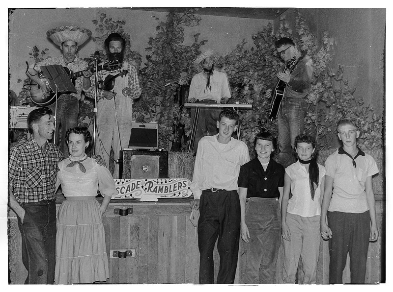 my father ( in glasses with guitar ) at a barn dance 1957ish.