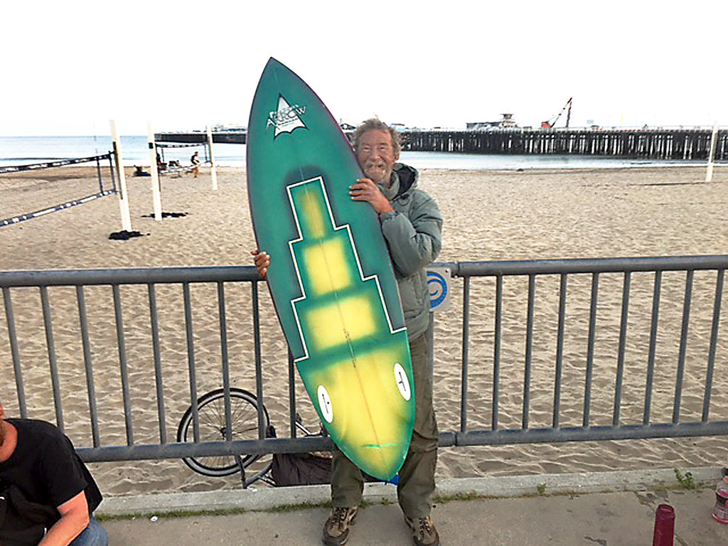 . Former surfing great, Kevin Reed, now known as Kevin Callahan, was arrested on Sunday for suspected murder. Police released him the next day without charges. Reed has been homeless for a few years, drinking heavily and generally having a hard time in life, according to a friend. Here he holds his signature model surfboard--the Kevin Reed Model Arrow twin fin--which he personally airbrushed and hangs on display in Arrow Surf Shop. (Bob Pearson -- Contributed)