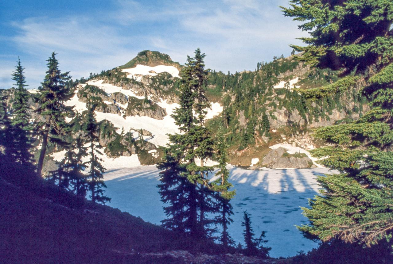 IMAGE: https://photos.smugmug.com/The-West-mostly-1971-75/High-country-hiking/i-CpjbWvb/0/e8865d30/X2/12%20Cascades%20tarn-X2.jpg