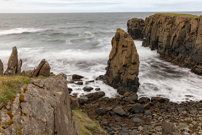 The rocky promontories and wild waves of the far Northern coast of Iceland deserve respect