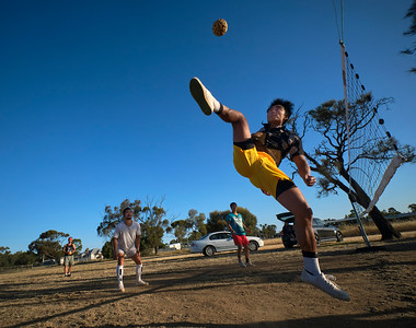 Caneball, an ancient East Asian sport, being played in a paddock at Nhill by new locals, once Karen refugees.