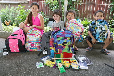The Wish Project is having its yearly drive to collect backpacks for kids who need them for the school year. Holding onto their new backpacks is from left Jadalyse Mingo, 10, Timmy Martell, 4, Ayannalyse Mingo, 5, and Jay Ortiz, 5. SUN/JOHN LOVE