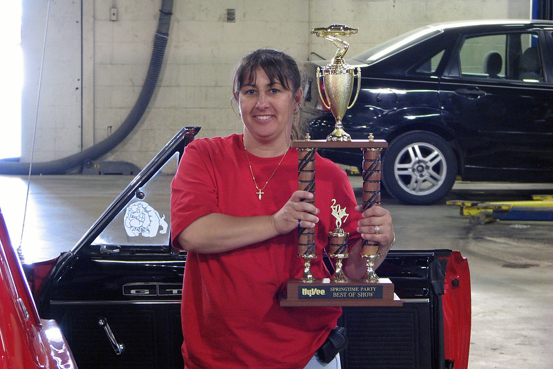 Truth be told, the car actually belonged to Kelly's wife, Andrea, who was quick to confirm that this was, indeed, her car.  The local HyVee grocery store hosted a car show earlier in the day.  Andrea was rightfully proud of the Best of Show trophy she just won.
