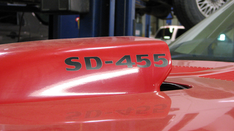 The SD-455 designation on the hood usually means the car has the super rare Super Duty 455 CID V8.  But that isn't the case here.  According to the VIN number, this car is a 1974 Trans Am with a 400 CID V8.  It also has an automatic transmission which makes it 1 of 2,914 made that year with that combination.