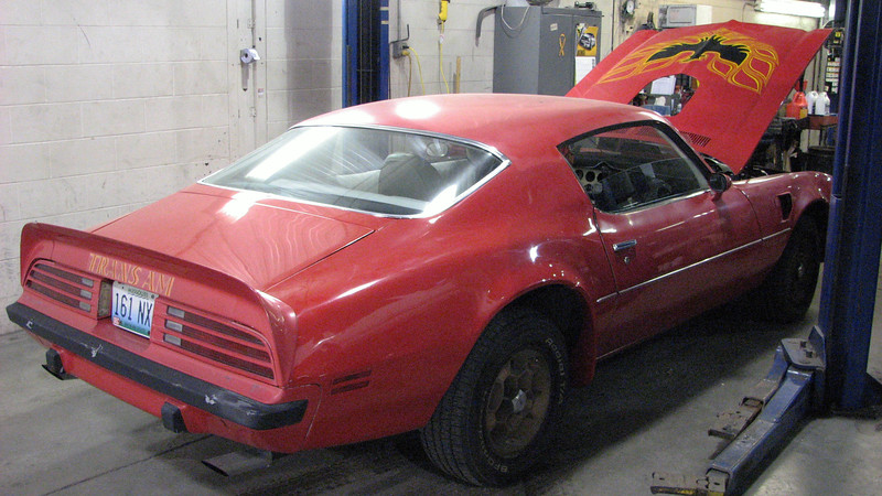It's a 1974 Trans Am with a 1973 front clip.  So the headlights and grill are from a 1973 model.
