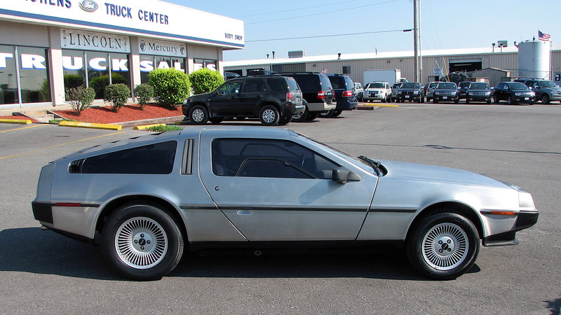 The most distinctive aspect of the DeLorean is its stainless steel body.  No DeLorean left the factory painted.