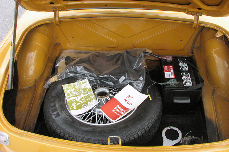 It had a spare tire, original center cap wrench, and owner's manuals in the trunk.