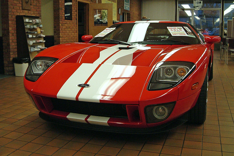 I remember seeing three new Ford GTs pass through the Joe Machens Ford showroom when I worked there.  This stunning Mark IV Red Clearcoat Ford GT was actually delivered on Friday October 15.