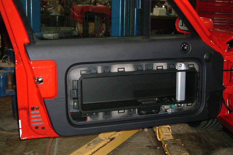 Part of the door trim panel removed.