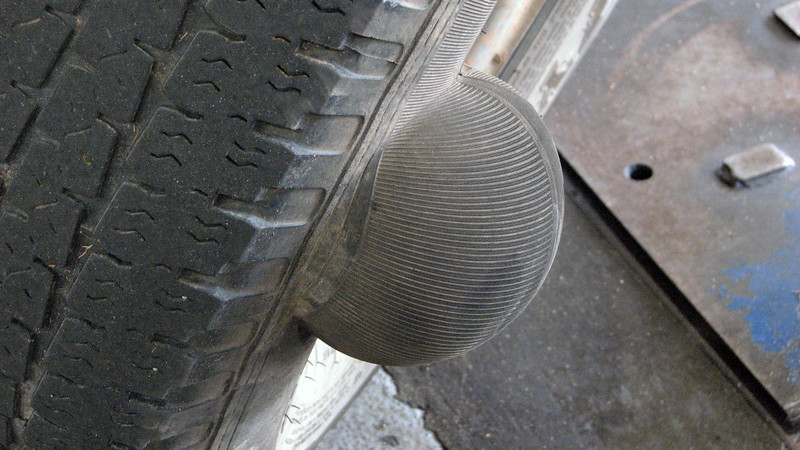 I don't know if this was some kind of impact damage, or just a problem with the layers of the tire.  Either way, the tire still held air at this point.