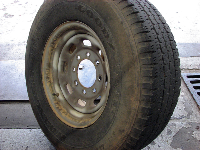 A Ford F250 arrived in the shop today for a vibration concern.  Tech A. J. verified the concern and pulled the truck inside to investigate.  He traced the problem to the tire seen in the photo above.  Everything looked ok from this angle.