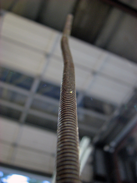 It wasn't pretty, but it worked.  Now all the customer has to do is hope the all-thread, which isn't designed to flex like an antenna, doesn't get caught on anything.