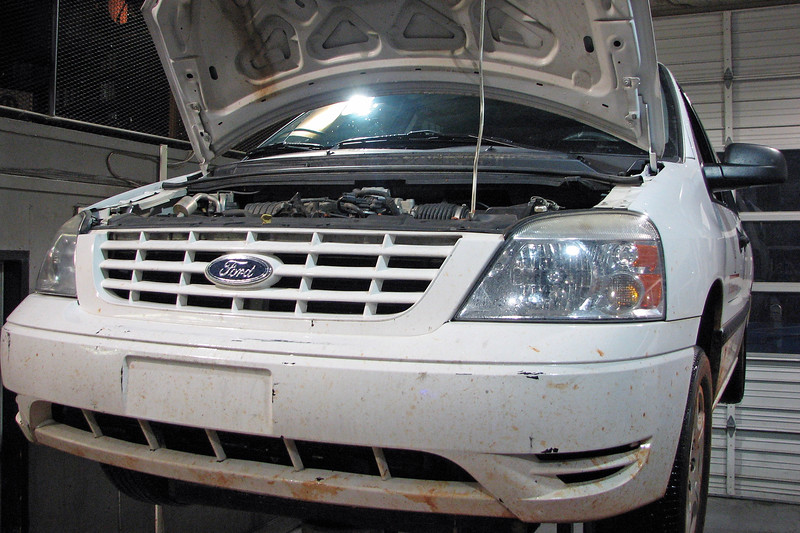 This 2005 Ford Freestar minivan arrived at the shop to have two concerns addressed.  It seems that the last time this van was out in the field, the driver reported hearing several unusual noises while on the way back to campus.  Also mentioned was a vibration that was described as noticeable but not real bad.  The noise concern was associated more with braking, but the vibration was not, which is unusual.  Since the first step in ANY repair process is to verify the concerns, I headed off for a road test.<br /> <br /> As is the case with a lot of noises, I was unable to duplicate the concern.  I couldn't feel or hear anything unusual happening with the application of the brake pedal.  However, the reported vibration was definitely there.  Curiously, I found it present at idle in park as well as while driving down the road.  Another unusual symptom was that the MIL was off, indicating I probably wasn't dealing with something like an engine miss or an EGR concern.  It looks like the vibration concern will be the place to get the diagnostics process started.