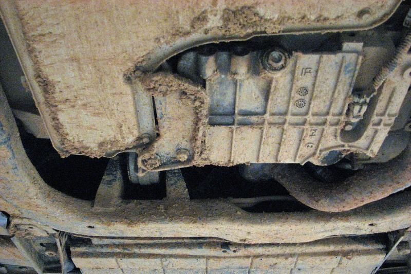 Mud on the transmission pan and front subframe.