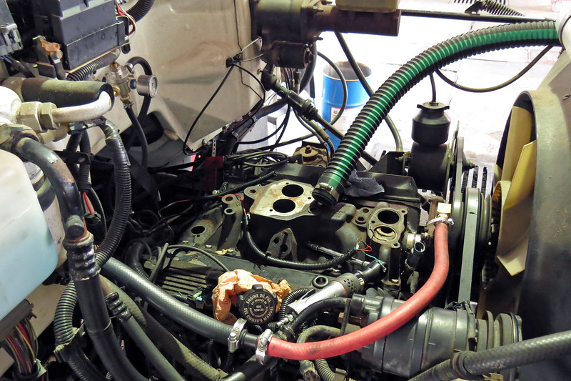 He then reinstalled the factory manifold.