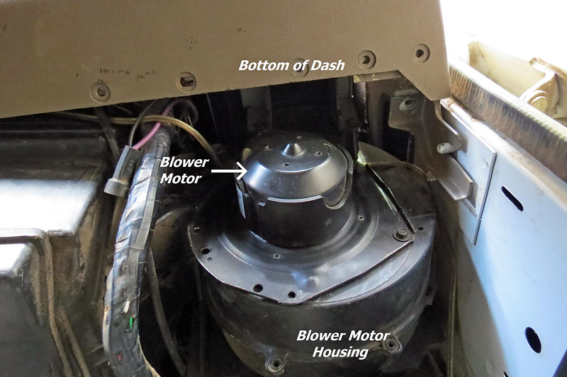 I stared at the dilemma before me for a minute or two.  With flashlight in hand, I carefully examined everything in that immediate area to make sure I was not missing anything obvious.  The motor and fan are a fixed size.  The blower motor housing is bolted to the bulkhead and can't go anywhere.  The dash is securely fastened to the body of the truck and can't go anywhere either.  Yet the motor/fan assembly can't fit through the provided opening between the bottom of the dash and the blower motor housing.  <br /> <br /> This means that this repair, which should be a simple plug–'n–play part replacement, can't be completed until I first move the instrument panel to gain enough space.  How did this design get beyond the discussion phase ?