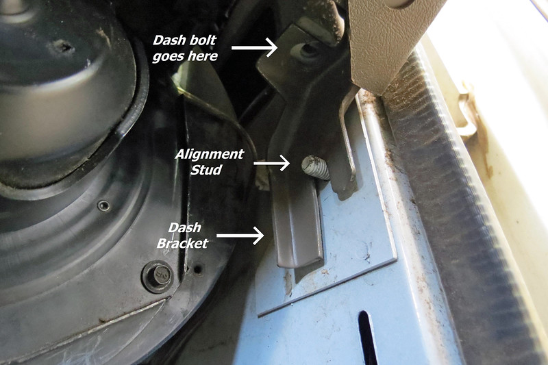 Looking at the photo above, moving the dash rearward involves prying the dash bracket off of the alignment stud.  With the bracket free, I lifted the corner of the dash and pulled rearward while lifting upward at the same time.