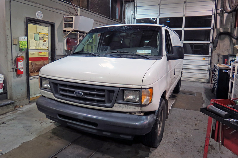 The Library Van, as it's known around here, was in the shop on this evening for its regular maintenance service.  This 2003 Ford E150 cargo van has become famous around here.