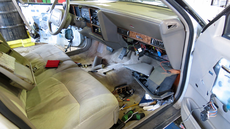 I headed to the passenger side front door next with the same results.  By this time, I was starting to get quite a pile of parts that eventually had to be reinstalled.