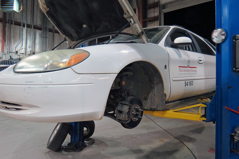 """This Ford Taurus wagon arrived this evening for its regular maintenance service and for a """"losing air"""" concern for the left front tire.  I picked the car up and started doing the service and to see what I could find."""
