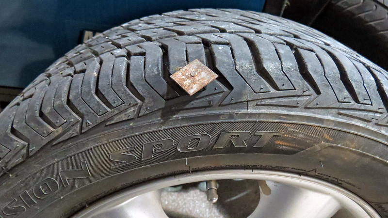 A long nail had found itself stuck in the edge of the outer sidewall of the left front tire.