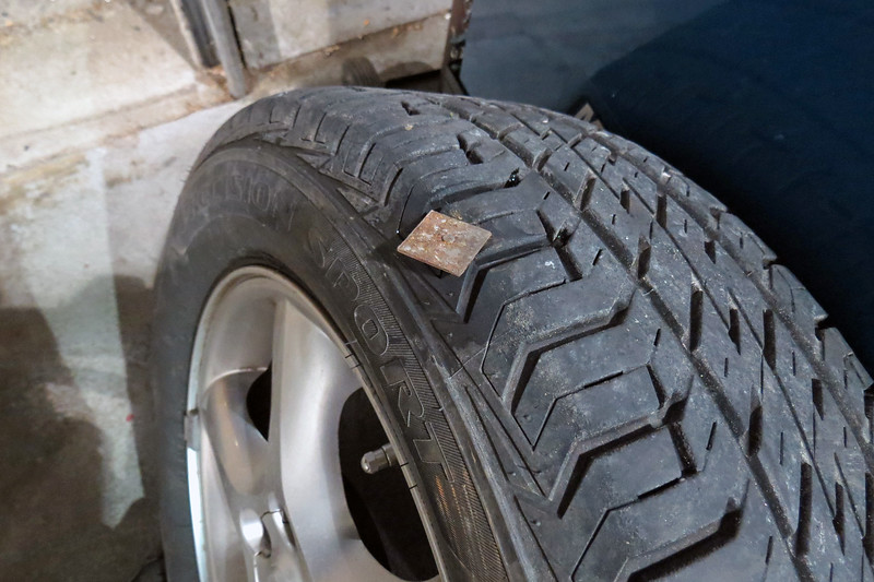 The problem with the tire turned out to be more than obvious.  Truth be told, I could actually hear the low speed clicking while driving the car into the shop.
