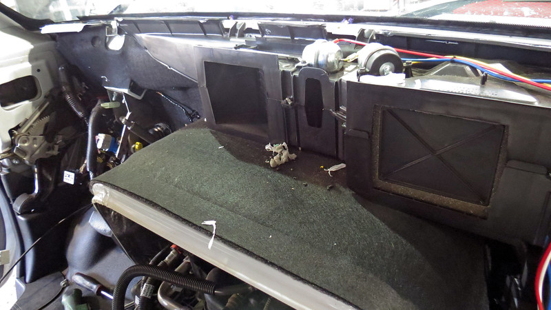 After removing all of the necessary trim and dash mounted components, I unbolted the instrument panel from the body of the van and slid it back onto the front seats.  Here is where Mr. Squirrel did a good bit of damage.
