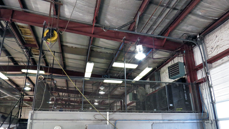 My shop is divided into two repair areas, one for cars and light trucks, and the other for heavier trucks.  They are separated by a break room and parts office that also features a second floor that has been used for storage.