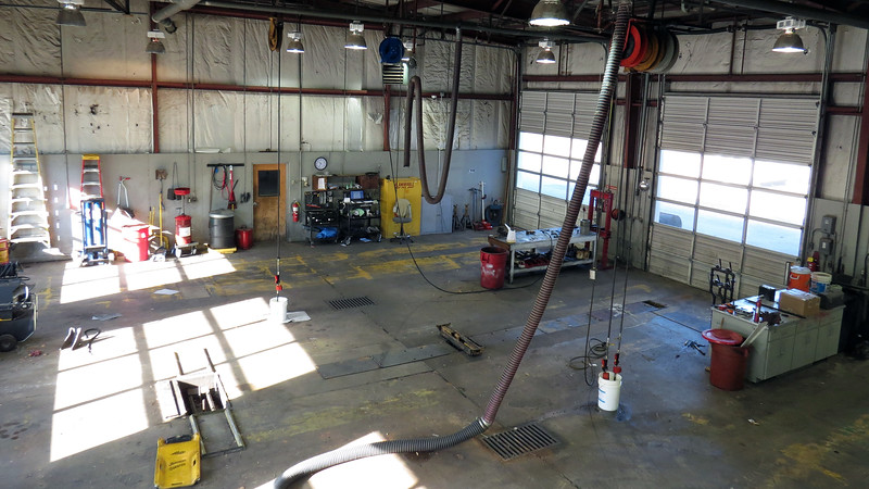"In addition to relieving the enormous amount of clutter, the cleanup was also partially motivated by discussions of moving the Shop Foreman's office back to this location in the future.  That is actually not a bad idea as ""upstairs"" provides a good view of the shop.  The heavy truck side of the shop is seen in the photo above."