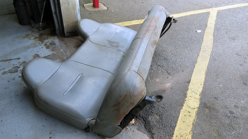 """Technician Wendel needed to replace a seat belt buckle on an old Chevrolet K1500 """"farm truck.""""  This is one of those trucks that spends its days on the farm, rarely going """"on road"""" except to come to the Automotive Center for repairs."""