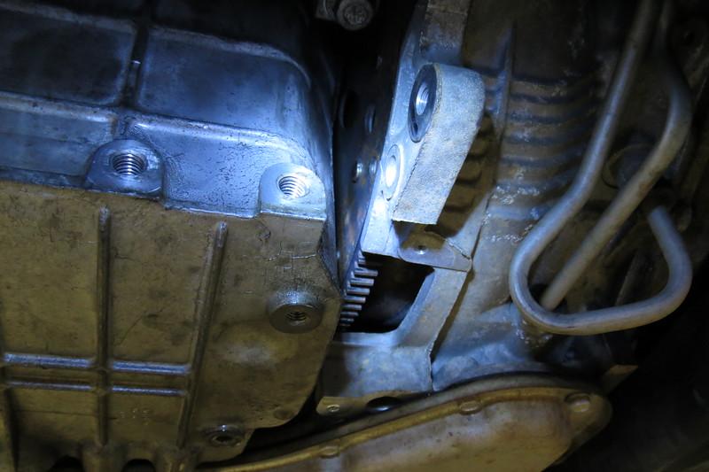This is looking under the van.  The torque converter/flywheel cover is missing.
