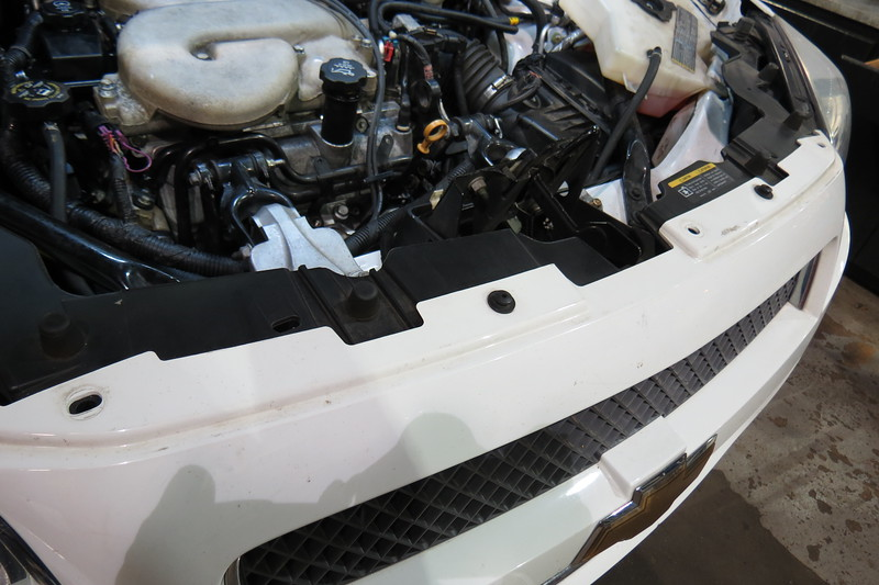 Three of the five plastic fasteners are missing from across the top of the front fascia.