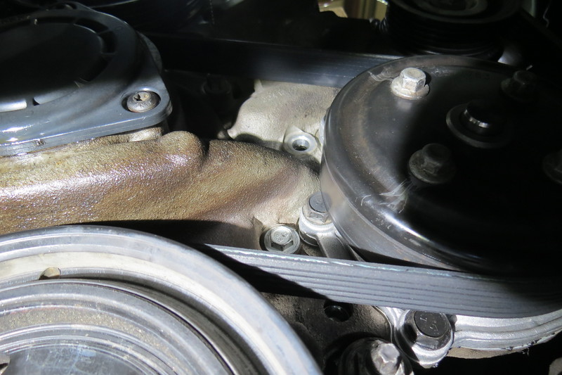 This is looking above the water pump where one of the crossover bolts is missing, (the empty slot can be seen in the center of the photo above).
