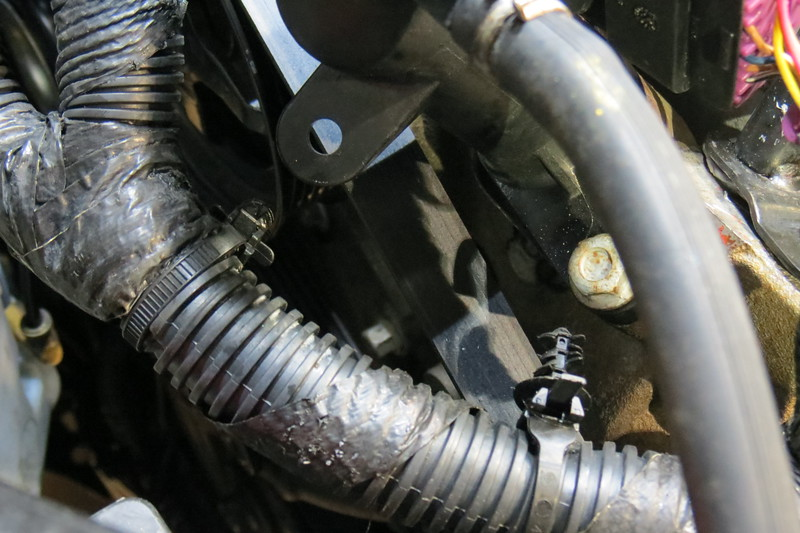 This is looking at the right front of the engine compartment above the serpentine belt.  When I initially opened the hood, I found the engine wiring harness hanging completely loose.  The plastic zip-tie fastener on the left in the photo above was not clipped into its holder.  The plastic zip-tie fastener on the right is supposed to be clipped into a small bracket that is missing.