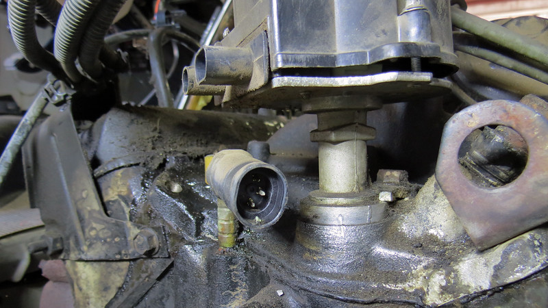 To do this, I made a mark in the distributor base and on the intake manifold with a small punch.