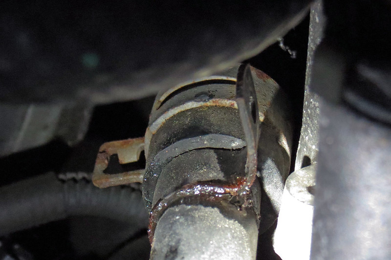 But zooming in on the area, there was enough corrosion present where the bracket is tack welded onto the metal pipe to make me wonder if the leak was coming from the metal.