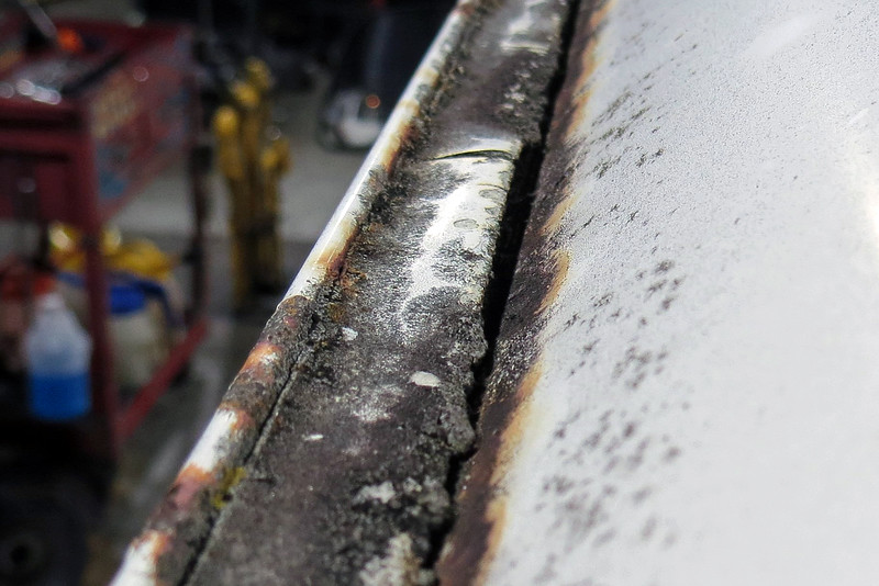 The seam sealer has deteriorated to the point where a large gap has appeared.