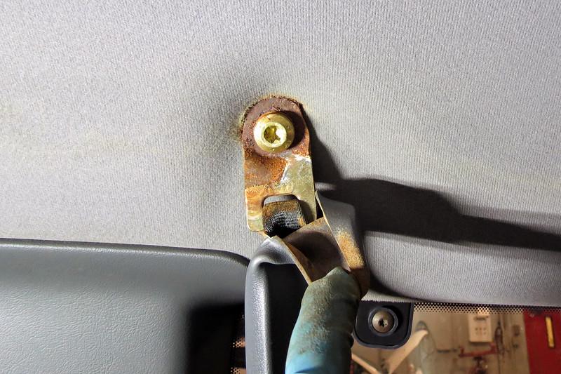 Left side seat belt retractor bracket.