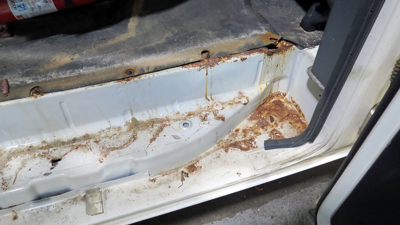 I removed the side cargo door step to find a significant amount of rust.