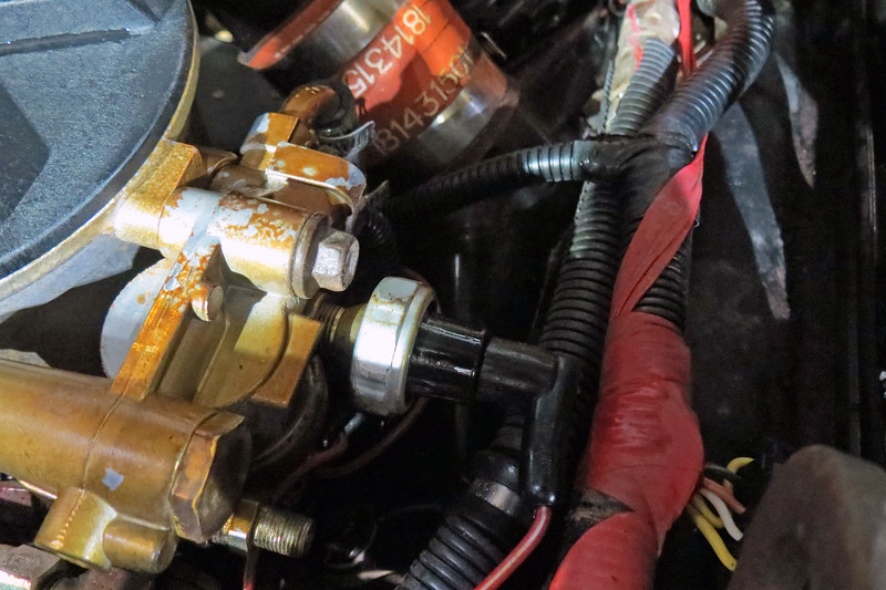 This is a fuel pressure sensor and is mounted on the side of the fuel filter housing.
