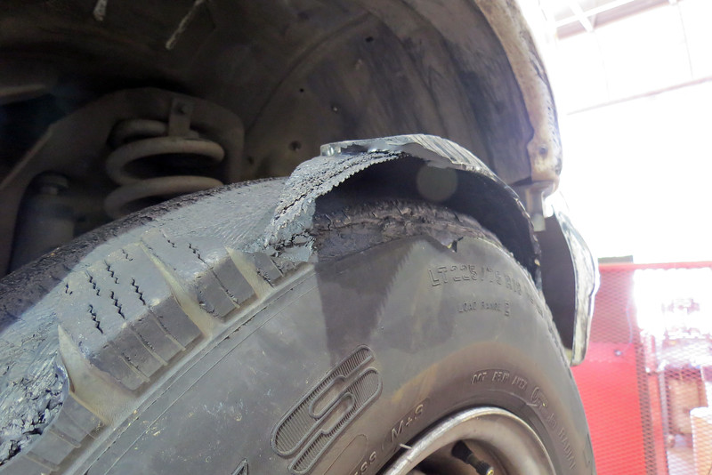 Every time the tire rotated, the pealed tread hit the inner splash shield.
