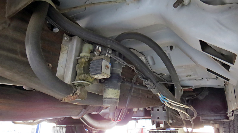 I traced the leak to the auxiliary coolant pump mounted under the floor on the right side of the cab.